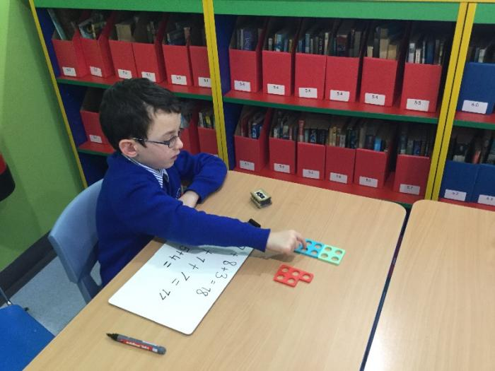 Using numicon to add 3 numbers
